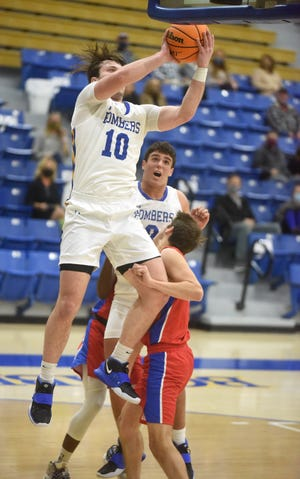 Mountain Home's Mat Jones goes up for two against Paragould on Tuesday night at The Hangar.