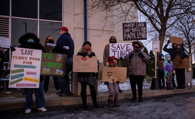 Members of the public protest outside Muncie City Hall on Dec. 1 to voice their discontent with a proposed plan for the YMCA to build a new facility at Tuhey Park.