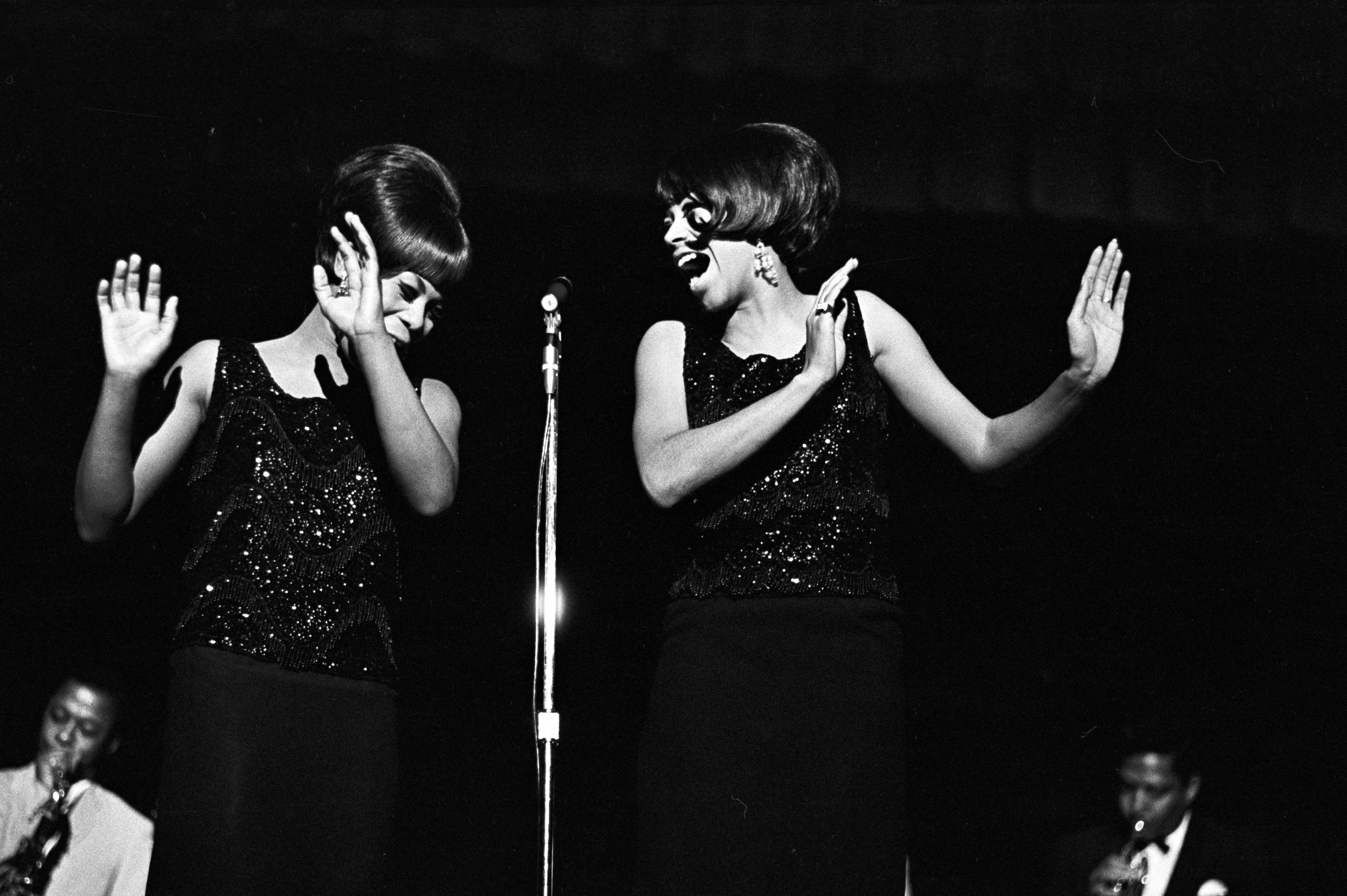 Gladys Horton and Katherine Anderson of the Marvelettes, singing on stage during a performance of the Otis Redding Show.