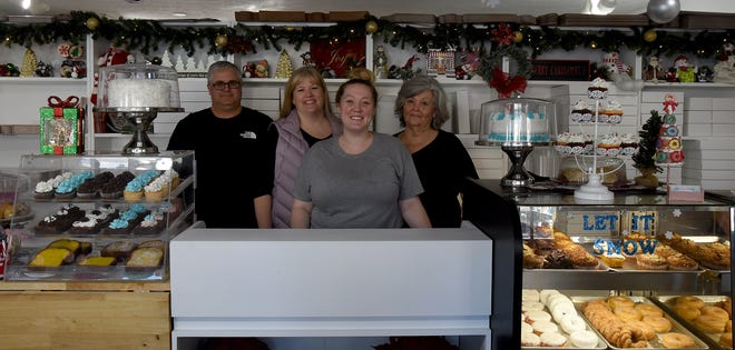 Scott Budreau, Kathy Budreau, Brittany Budreau and Sally Deckard are the three generations behind Sugary Sweet Bakery in Granville. Kathy and her daughter Brittany do much of the baking and run the place using grandmother Sally's recipes.