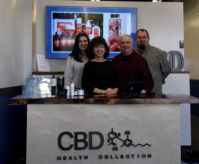 Ashley Marienau, Rosemarie Bauer, Rick Bauer, and Jon Bauer are the family behind CBD Health Collection in Granville.