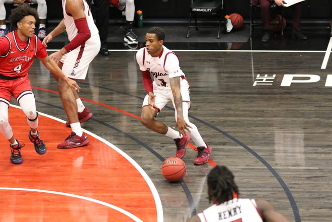 Senior guard Evan Gilyard looks for a driving lane during New Mexico State's game against Benedictine University at Mesa on Dec. 1, 2020, in Phoenix, Arizona.