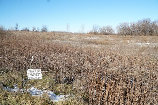 The Kensington Ridge development would occupy this parcel, currently the Milford Sand and Gravel Co., along Milford Road, south of Maple.