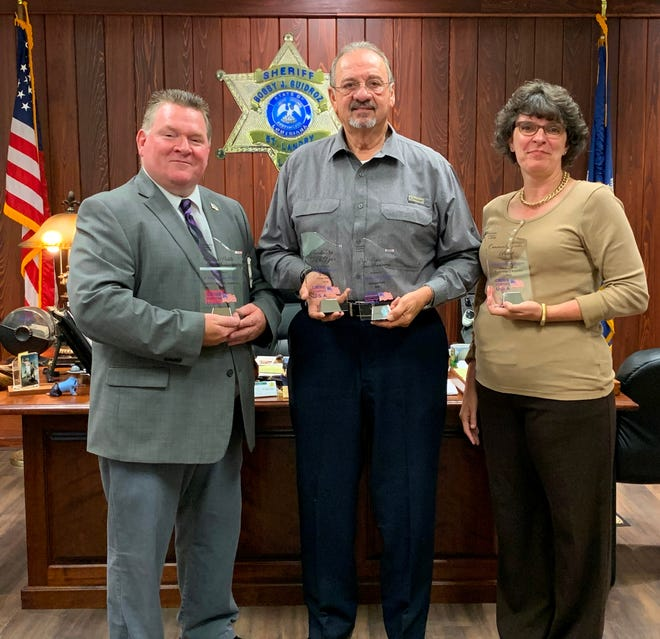 St. Landry Parish Sheriff Deputy Chief Eddie Thibodeaux, Sheriff Bobby J. Guidroz, and Crime Stoppers Administrative Assistant Sgt. Beth Bernard hold the awards given to the St. Landry Crime Stoppers.