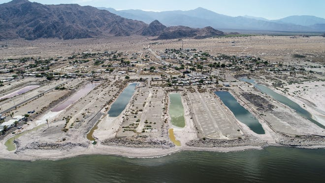 The remaining water in former inlets is hypersaline and get its colors from salt-loving microbes as the Salton Sea slowly recedes away from Desert Shores,  July 13, 2020.