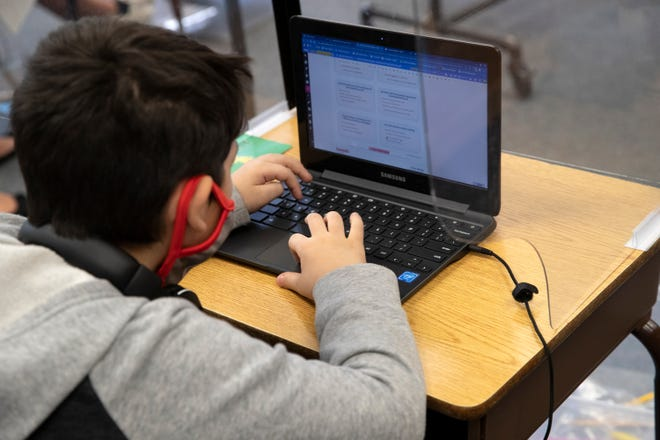 Sunny Sands Elementary School students engage in their grade-level teacher's online instruction at the school site learning hub in Cathedral City, Calif., on Friday morning, November 20, 2020. The cohort is currently limited to 14 students.