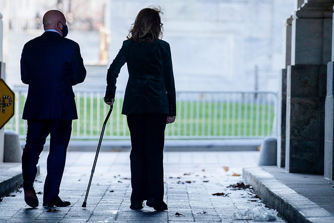 Sen. Mark Kelly (D-AZ) and his wife, former U.S. Rep. Gabrielle Giffords walk into the US Capitol for his swearing in on Dec. 2, 2020 in Washington, DC. Kelly, 56, a former astronaut, defeated Sen. Martha McSally (R-AZ) last month.