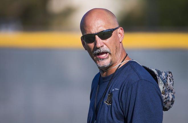Coach Dan Hinds runs football practice at Desert Vista High School, Wednesday, October 3, 2018.