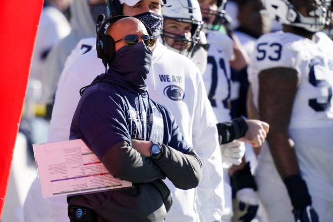 Penn State head coach James Franklin watches from the sideline during the second half of an NCAA college football game against Michigan, Saturday, Nov. 28, 2020, in Ann Arbor, Mich. (AP Photo/Carlos Osorio)