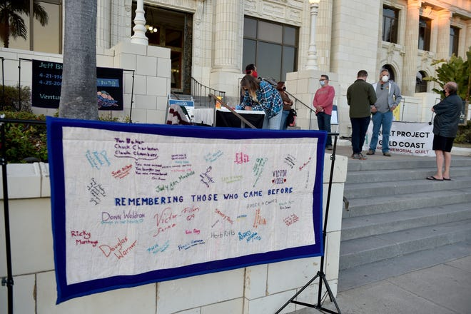 Supporters of the nonprofit Quilt Project Gold Coast gathered at Ventura City Hall on Tuesday, Dec. 1, 2020, to commemorate World AIDS Day with a display of quilts and a sunset candlelight vigil.
