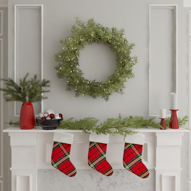 A wreath and garland can create holiday cheer without taking up too much room. A report by Modsy said Texans are decorating for the holidays more than ever this year.
