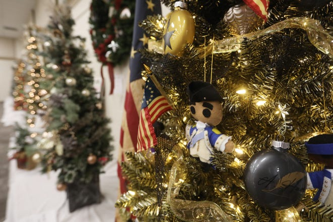 A Hamilton themed Christmas tree from Varsity Title at the Zanesville Muskingum County Welcome Center for the Festival of Trees.