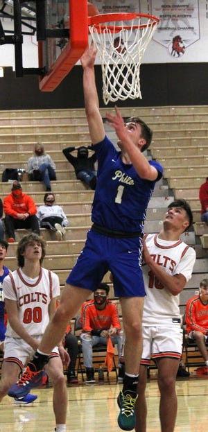 Philo's AJ Clayton (1) take the ball to the bucket during the Colts versus Electrics boys' basketball game at Meadowbrook High School Tuesday evening.