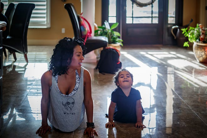 Lena Hale and her daughter, Rosalee, practice yoga at Rosemary and Jerry Hale's home in Beverly Beach, Fla., on Wednesday, October 16, 2019. [THOMAS CORDY/palmbeachpost.com]