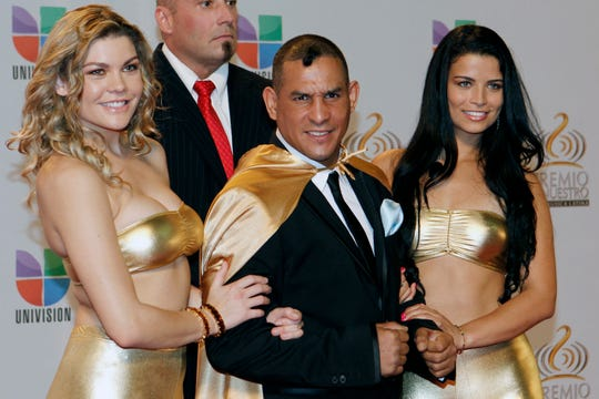 "Hector ""Macho"" Camacho poses for photographers as he arrives to the Premio Lo Nuestro Music Awards in Miami, Florida, in February 2012."