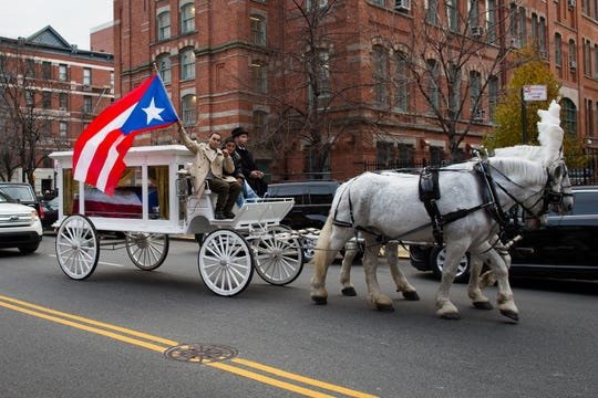 "Former boxing champion Hector ""Macho"" Camacho's funeral carriage approaches St. Cecilia's Roman Catholic Church for his wake."