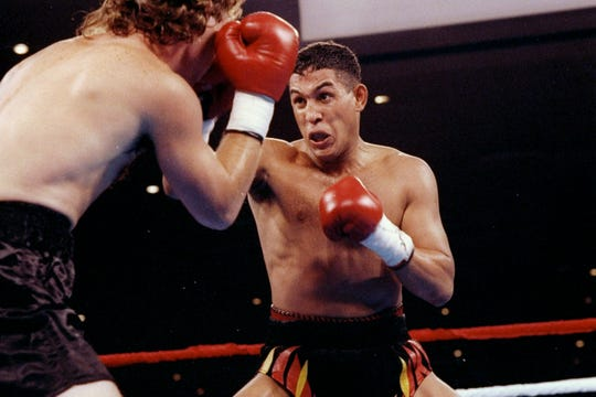 Hector Camacho (right) trades blows with Eddie Van Kirk during a fight Aug. 1, 1992