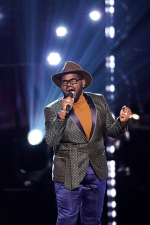 "John Holiday, an associate professor of music at Lawrence University's Conservatory of Music in Appleton, competes on Season 19 of ""The Voice."""