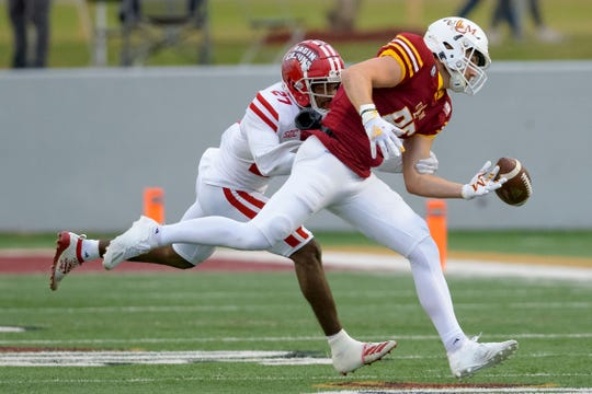 Louisiana-Monroe tight end Josh Pederson (86) drops a pass while being defended by Louisiana-Lafayette safety Cameron Solomon during their game in Monroe, La., Saturday, Nov. 28, 2020.