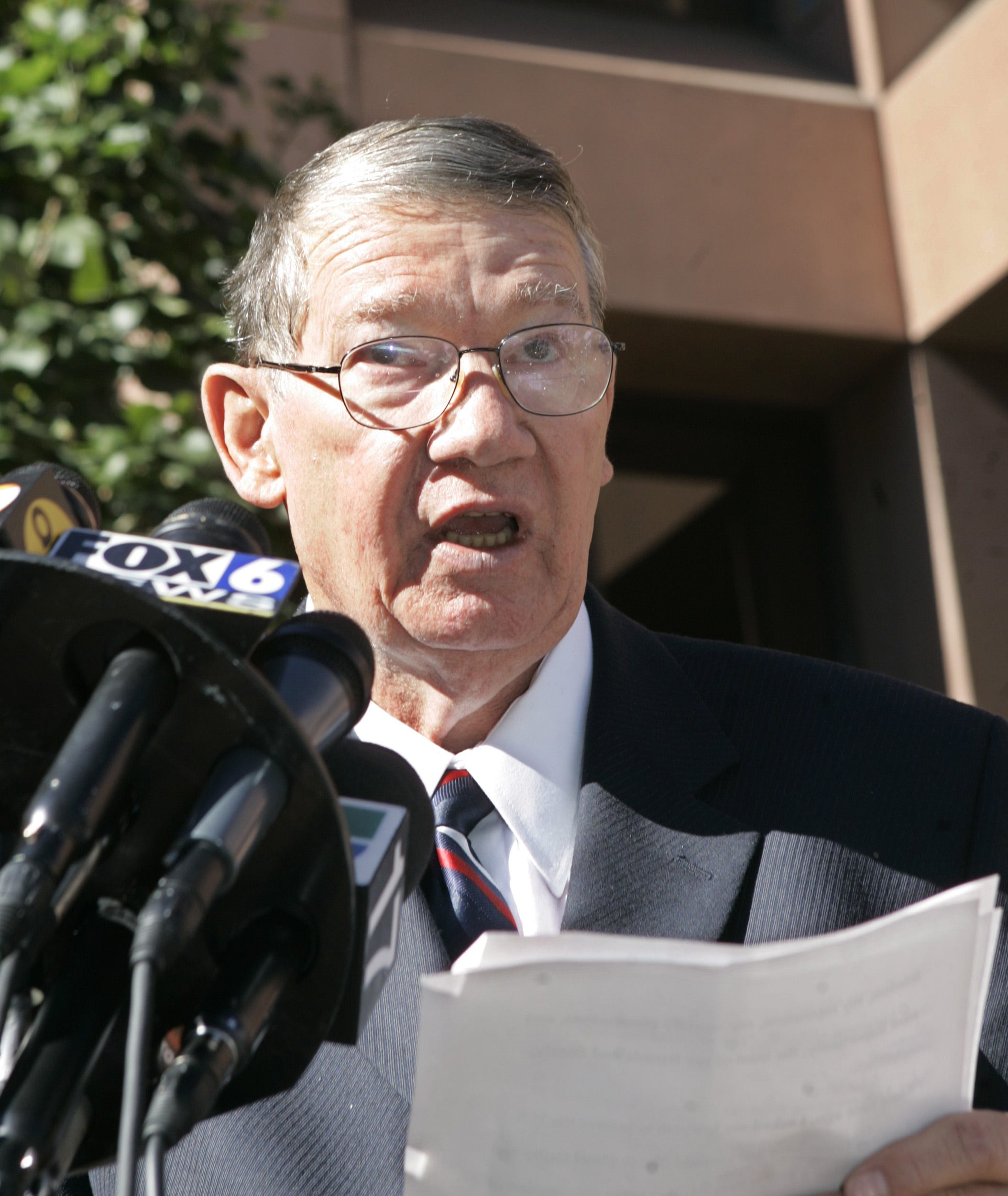 """Republican Congressman Randy """"Duke"""" Cunningham,  of the 50th district in California,  reads a statement outside the federal courthouse in San Diego Monday Nov. 28, 2005 where he pled guilty to conspiring to commit bribery, honest services fraud, and tax evasion.  (AP Photo/Lenny Ignelzi) ORG XMIT: CALI105"""