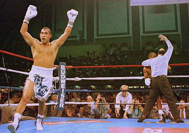 "Hector ""Macho"" Camacho exults as referee Joe Cortez stops Camacho's bout with ""Sugar"" Ray Leonard during the fifth round in Atlantic City, New Jersey, in 1997. Erie-based boxing promotor Michael Acri is an executive producer for a new documentary on Camacho for Showtime."