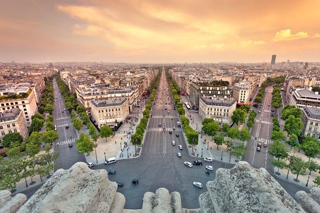 The wide sidewalks of the Champs-Elysées invite strolling.