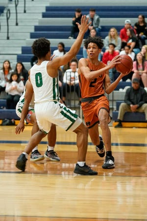 Jailen Bedford, right, scored 33 points in Hutto's 77-70 win over Copperas Cove on Tuesday. Bedford, a senior guard, is averaging 20 points this season. [LOURDES M SHOAF/for Statesman]