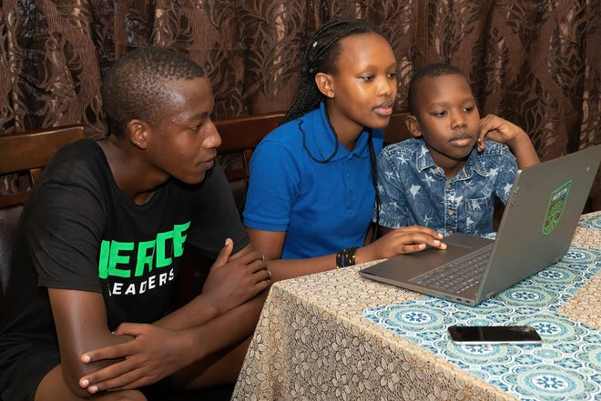 Bienfait, 15, Gloria, 13, and Blessing, 8, Byishimo have learned how to use computers since coming to the U.S. in 2019.