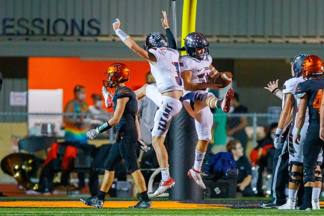 Wimberley running back Kerrick Lai, right, celebrates his touchdown run with quarterback Matthew Tippie in a first-round playoff win over Smithville. The Texans will face district rival Geronimo Navarro in Friday's Class 4A Division II Region IV title game. [JOHN GUTIERREZ/FOR STATESMAN]