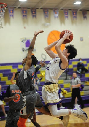 Sebring McKinley's Connor Shepherd pulls up for a short jumper in a non-conference game against the Academy for Urban Scholars Wednesday, December 2, 2020 at McKinley High School.