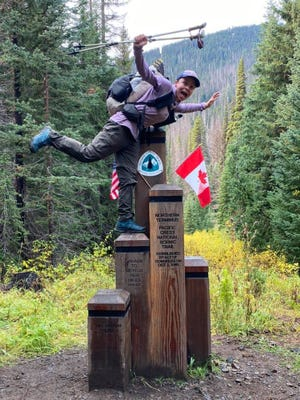 Hales Brown at the terminus of the 2,653-mile-long Pacific Crest Trail. The trail stretches the entire West Coast from the Mexican Border to Canada, and Brown hiked its entirety over the course of 142 days this summer.