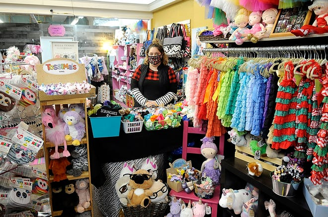 Megan Steffen is seen inside her store, Whoopsie Daisy Bowtique, 122 E. Main St., on Thursday. Sandra Tunnell of Ashland Main Street is offering a delivery service for downtown businesses starting next week. She will be delivering online orders anywhere within city limits.
