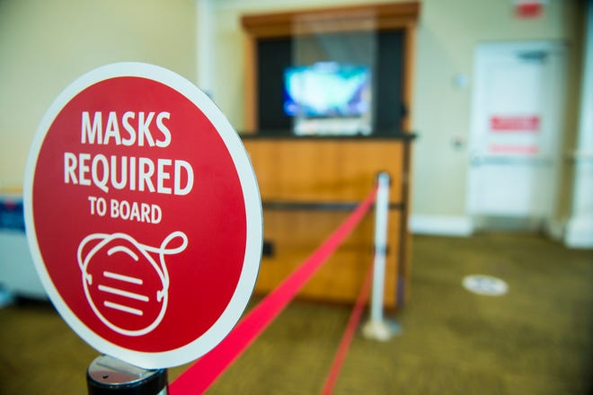 Signs at Augusta Regional Airport remind passengers to wear their masks onboard the aircraft. [MICHAEL HOLAHAN/THE AUGUSTA CHRONICLE]