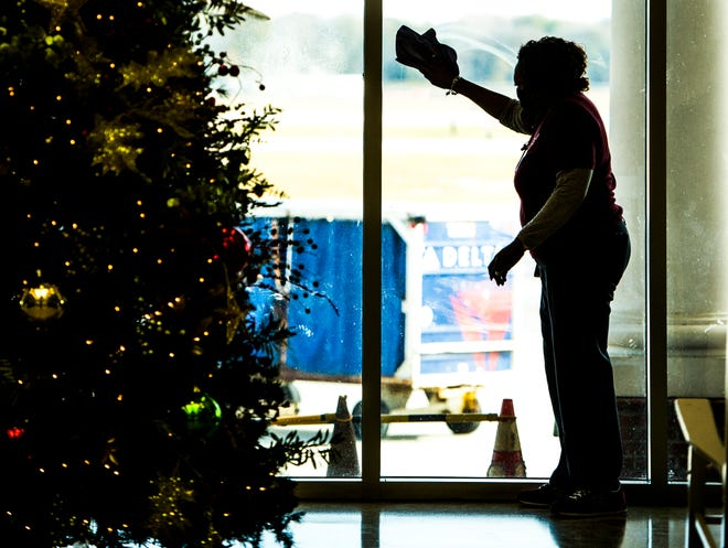 Workers at the airport try to keep things clean and COVID free like this woman cleaning the windows at the Augusta Regional Airport in Augusta, Ga. The airport will be receiving more than $2 million in aviation funds through federal grants.