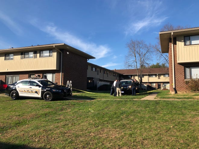 Middletown Police gather outside the Racquet Club Apartments, where a 2-year-old boy was shot and killed in his home Dec. 2.