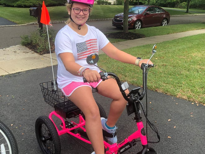 Mckenna Ellixson, 11, of  Doylestown Township, on her Liberty Trike earlier this year. Electric Bike Technologies Inc., of Bristol Township, gave 10 tricycles to children living with spinal muscular atrophy in 2020 and plan to double that amount in 2021.