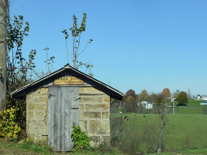 A shed for the Taber Farm, the Olney Friends School, stands out against Barnesville farmland.