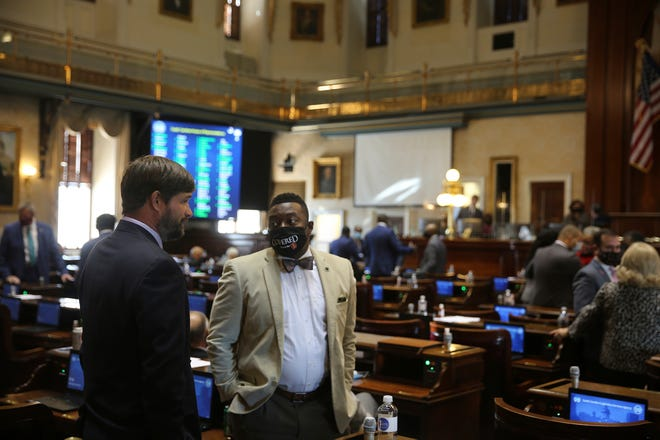 State Rep. Ivory Thigpen, D-Columbia, speaks to a fellow South Carolina House member Wednesday in Columbia.