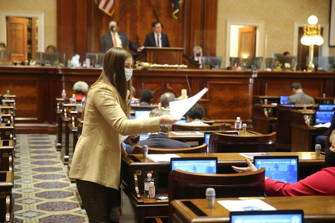 A page hands out committee assignments in the South Carolina House on Wednesday in Columbia.