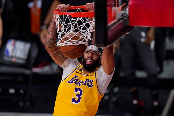 Los Angeles Lakers' Anthony Davis (3) slams a dunk against the Miami Heat during Game 1 of the NBA Finals in September in Lake Buena Vista, Fla. Davis is finalizing a five-year contract worth up to $190 million to return to L.A.