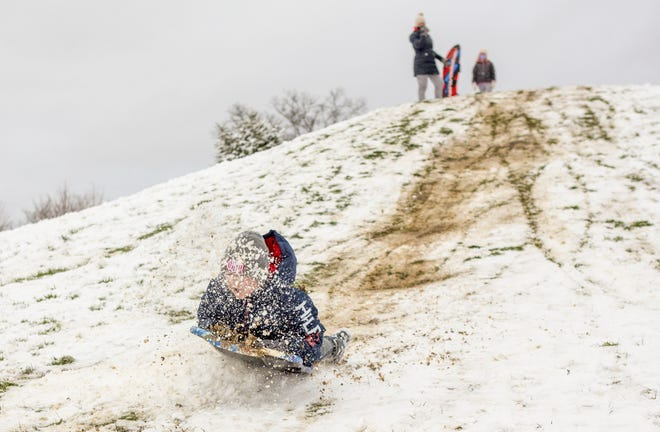 Vinny DuPuy, 9, of Worthington, gets a face full of snow and mud as he hits a ramp on the hill at the city of Worthington park on Wilson Bridge Road on Dec. 1. Snow days may now be on the list of things the pandemic has canceled for good.