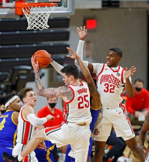 Ohio State Buckeyes forward Kyle Young (25) comes down with the rebound against Morehead State Eagles during the first half of their game at Covelli Center in Columbus, Ohio on December 2, 2020.