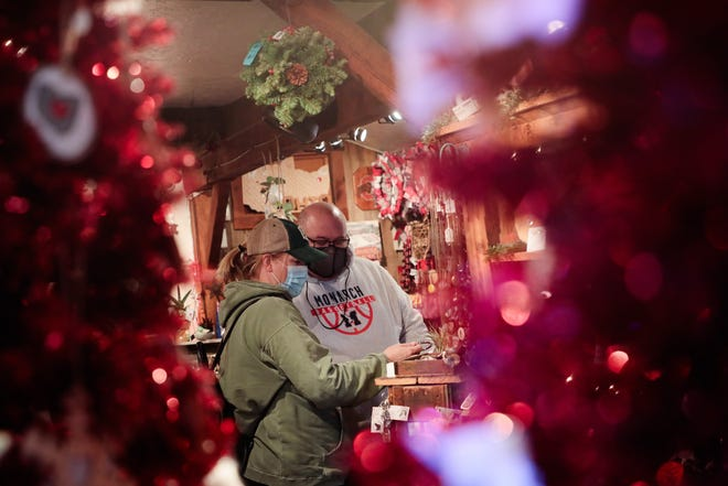 Nikki Welsh, left, and her husband, Matthew, of Marysville, shop for holiday decorations Thursday at Red Stable Gifts in German Village.
