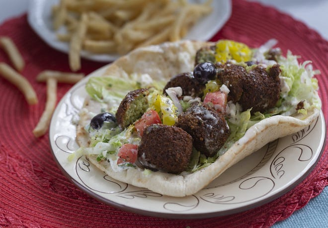 The falafel sandwich from the Taste of Greece and Moroccan food truck boasts a variety of toppings, including Kalamata olives.