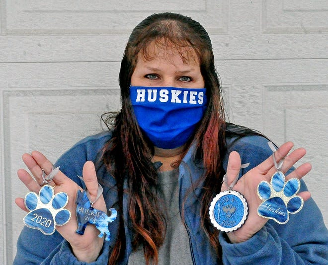 Allison Husk with her Northwestern Christmas ornaments she makes.