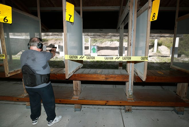 Shooters at Robert Strickland Shooting Range in Daytona Beach take aim at their targets recently. The range will be closing for 10 days beginning Monday to clean up lead from spent bullets and casings.