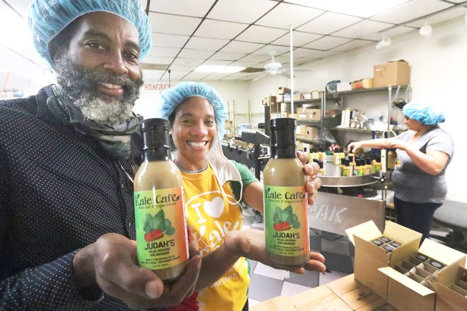 Omar Brown and Camille Holder-Brown, owners of Kale Cafe Juice Bar & Vegan Cuisine, hold the first two bottles of their Judah's salad dressing and marinade, at Stage Coach Sauces in Daytona Beach, Wednesday, Nov. 18, 2020.
