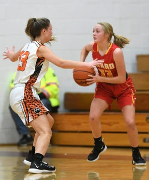 Harbor Creek's Shaelie Born, at left, guards Girard's Amber Carr, at right, during the championship game of the North East girls basketball tournament on Dec. 7, 2019, at North East High School. Winter sports for the 2020-21 regular season can officially begin Dec. 11 [CHRISTOPHER MILLETTE/ERIE TIMES-NEWS]