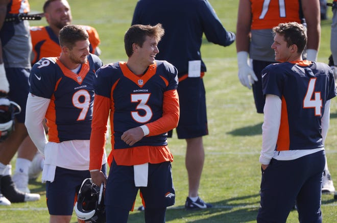 Denver Broncos quarterback Drew Lock, center, jokes with backup quarterbacks Jeff Driskel, left, and Brett Rypien during an August practice. Lock, Rypien and Blake Bortles were activated Tuesday and returned to practice Wednesday after having to sit out Sunday's game in quarantine because of Driskel's positive COVID-19 test.