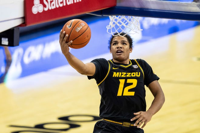 Missouri's Dru Smith glides in for a layup against Oregon during Wednesday's game in Omaha, Neb. The Tigers upset the 21st-ranked Ducks 83-75 to improve to 2-0.